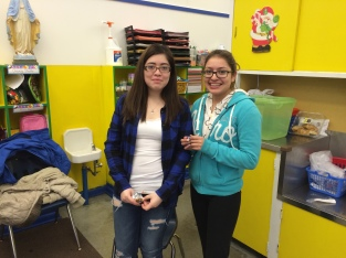 Kathia and Marisol after serving the kids a celebratory snack.