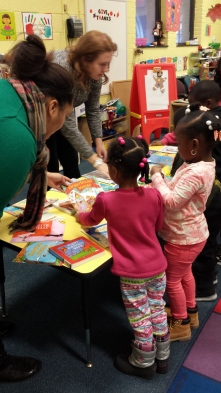 The kids at Peggy's Place pick their new books.