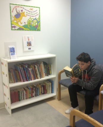 José reading while he waits for his appointment
