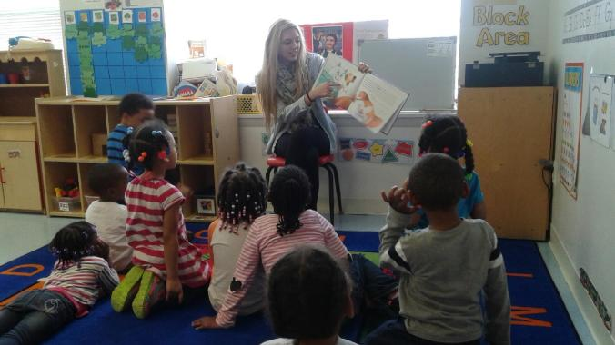 UDM student Alyssa Burgess reads with the kids at Emmanuel.