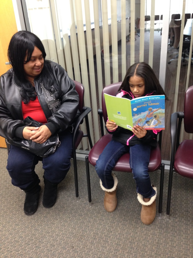 "Chastity Reads ""Young Harriet Tubman"" while her mom looks on"