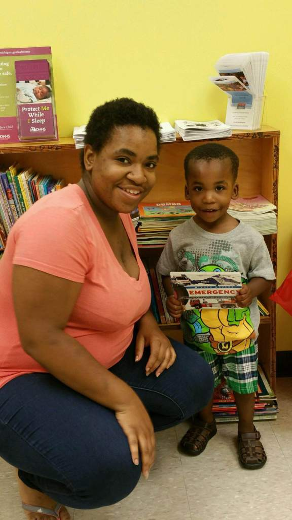 Christopher Boston and his Mom pick out a new book