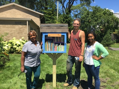 Clinical Nurse Manager (and Little Library Steward!) Alisa Smith and the library builders, Erik Krieger and Maya Faison.