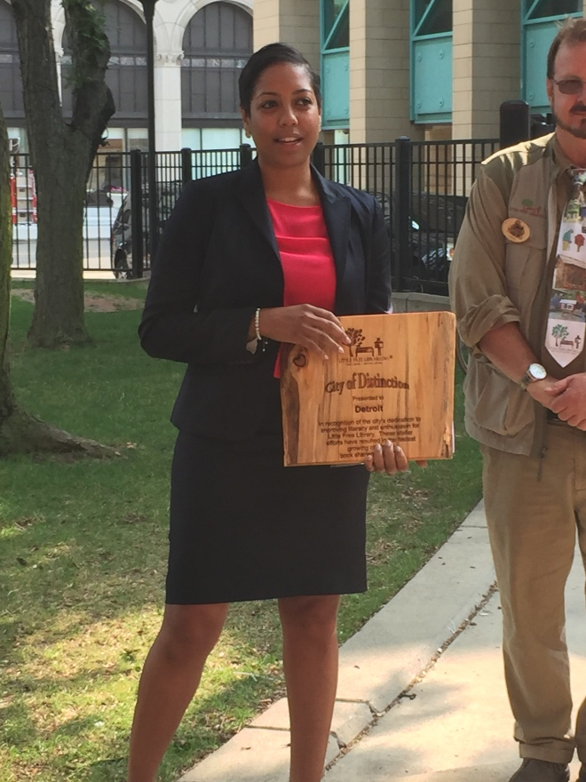 Ms. Aliyah Sabree, the Mayor's Liason to the City Council, accepts the award on behalf of the city.