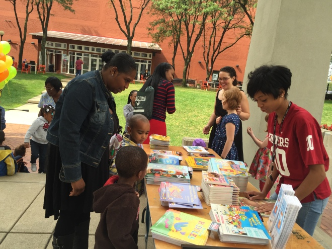 RX for Reading volunteer and UDM undergraduate Renesha Smoot Grafton helps kids pick out their books.