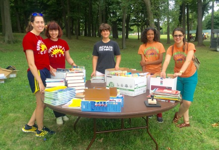 Summer in the City volunteers with some of the books from RX for Reading
