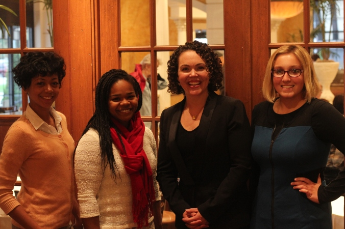 Rx for Reading volunteers Renesha Smoot Grafton, Maya Faison, and Emily Auten with Dr. Harrison.