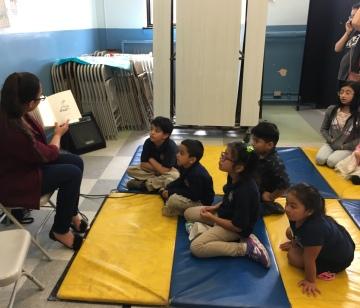 Ana Barajas reads for the El día de los niños/El día de los libros at César Chávez Elementary School